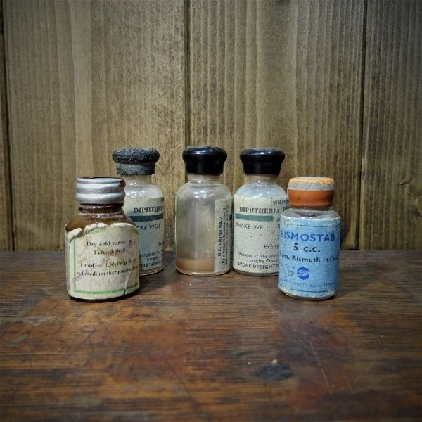 Five Tiny Medical Bottles